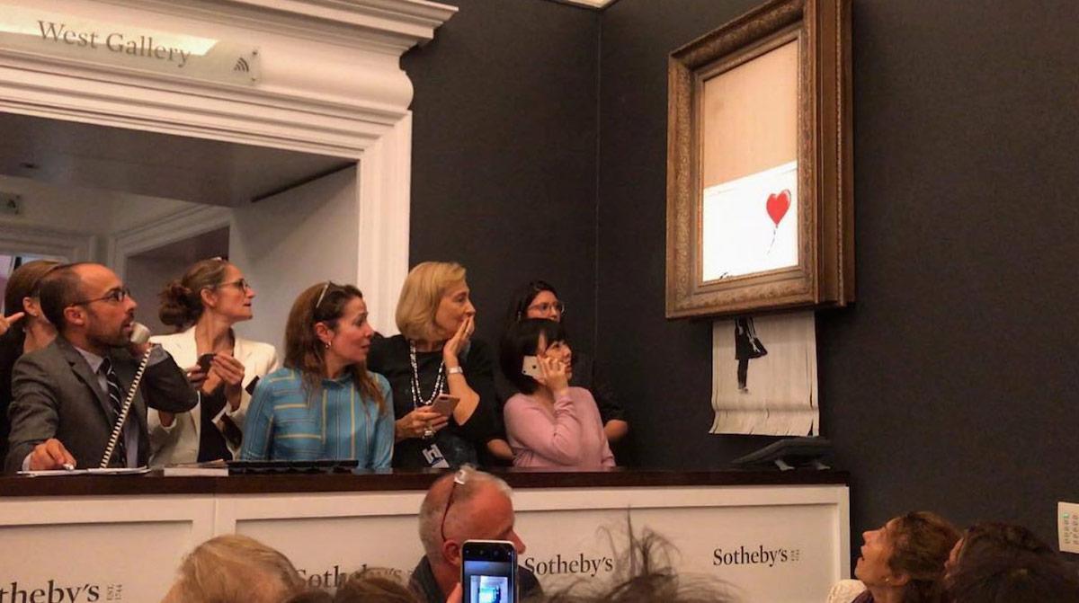 « La Petite Fille au Ballon » de Banksy, lors de son autodestruction en octobre 2018
